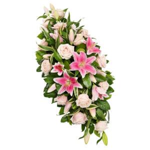 Palma pogrzebowa z róż i lili w różowej tonacji